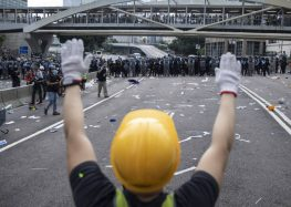 Hong Kong darkens as hard hats replace yellow umbrellas